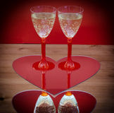 Valentine champagne glasses in heart Stock Photo