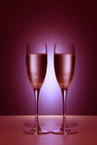 Valentine Champaigne Glasses. Valentine couple champaigne glasses with red light Royalty Free Stock Image
