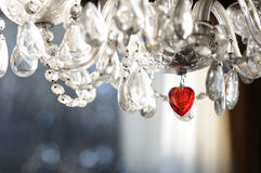 Valentine Chandelier. Glass chandelier with red crystal heart. Area for copy underneath if desired Royalty Free Stock Images
