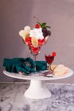 Valentine Cherry Dessert Portrait. Portrait of an elegant Valentine's Day cherry dessert with white and dark chocolate hearts, banana, whipped cream, and heart Stock Photography