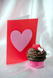 Valentine with chocolate frosted cupcake Royalty Free Stock Images