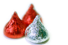 Valentine Chocolate kisses. Close-up image of 3 Valentine Chocolate kisses over a clean white background Stock Photos