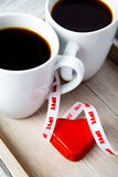 Valentine coffee cups with heart Stock Image