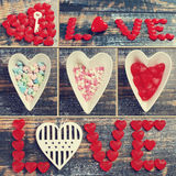 Valentine collage with love symbols on wooden background in vint. Valentine collage with love symbols and words on blue wooden background Stock Photos