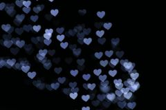 Valentine Colorful heart-shaped white on black background lighting bokeh for decoration at night backdrop wallpaper blurred valent Royalty Free Stock Photography