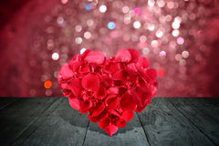 Valentine composition with heart shape made out of rose petals Stock Photo