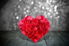 Valentine composition with heart shape made out of rose petals Royalty Free Stock Photos