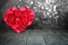 Valentine composition with heart shape made out of rose petals Royalty Free Stock Photography