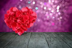 Valentine composition with heart shape made out of rose petals Stock Image