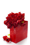 Valentine composition with shopping bag and red tulips Stock Photos
