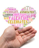 Valentine concept Asian male holding a heart shape tag cloud Royalty Free Stock Photos
