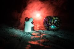 Valentine concept. Ceramic toys is hugging his couple for their love on dark background. Selective focus Stock Photography