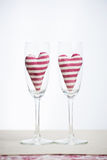 Valentine concept - champagne glasses with hearts Royalty Free Stock Photos