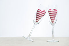 Valentine concept - champagne glasses with hearts Royalty Free Stock Photography