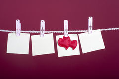 Valentine Concept: Empy notes with heart hanging Royalty Free Stock Image