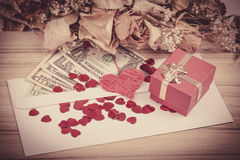 Valentine concept with hearts, dry roses and Stock Images