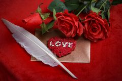 Valentine concept, love letter, rose on the dark background. Valentine`s day celebration with romantic items: sealed love letter, a rose on a dark red background Stock Image