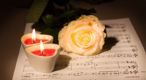 Valentine concept. Rose and two Heart  Candles. Beautiful rose, and two candles in the shape of heart Stock Photos