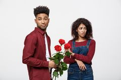 Valentine concept - young african american woman upset and ignore rose from her boyfriend. Valentine concept - young african american women upset and ignore Stock Photography