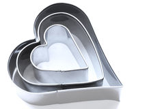 Valentine cookie cutters. Heart shaped cooke cutters  isolated on a white background Royalty Free Stock Image