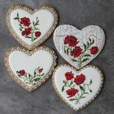 Valentine cookie heart decorated with red poppies in vintage style on gray background for Valentine`s Day, Mother`s Day, Women` stock image