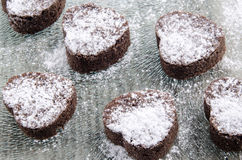 Valentine cookie with powdered sugar Royalty Free Stock Photos