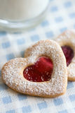 Valentine cookies. Home made valentine cookies with a glass of milk Stock Photo