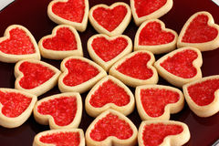 Valentine Cookies. Heart-shaped valentine cookies on a red plate Royalty Free Stock Image