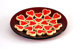 Valentine Cookies. Heart-shaped valentine cookies on a red plate Stock Images