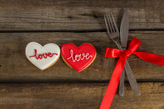 Valentine cookies and cutlery on a wooden background Stock Images