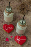 Valentine cookies, milk in a bottle and red hearts Royalty Free Stock Photo