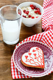 Valentine cookies on a plate with milk Royalty Free Stock Images