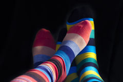 Valentine couple feet isolated. Colored socks on Valentine couple feet isolated on black Stock Photography