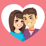 Valentine Couple On Heart. Cute young couple in Saint Valentine day on heart frame Stock Photography