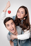 Valentine Couple. Portrait of Smiling Beauty Girl and her Handso Stock Photos