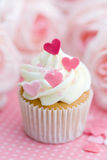 Valentine cupcake. Cupcake decorated with frosting and pink sugar hearts Stock Photography