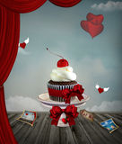 Valentine cupcake. In a fantasy scenery Royalty Free Stock Photography