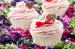 Valentine cupcake with heart and bow Royalty Free Stock Photos