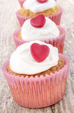 Valentine cupcake with white icing Stock Photo