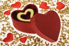 Valentine day. Golden heart as present at valentine day Stock Photos