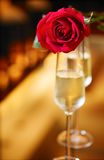 Valentine day. Red roses and glass of champagne Stock Photos