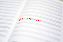 Valentine day abstraction on music sheet. Red symbols on white sheet Royalty Free Stock Images