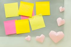Valentine day background blank post note paper sticky on glass w. Ith pink heart. image of business, present, idea, love, celebration, nobody, copy space Stock Image