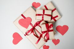 Valentine day background with gift boxes, red ribbon and hearts Stock Photo