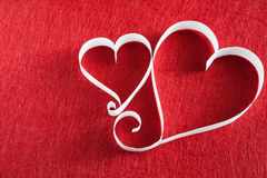 Valentine day background, handmade paper hearts on red felt Royalty Free Stock Photography