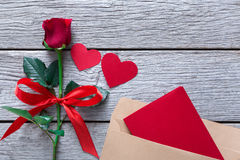 Valentine day background, hearts, card and rose flower on wood Royalty Free Stock Photo