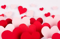 Valentine day background of many different paper hearts on white soft background. Royalty Free Stock Image