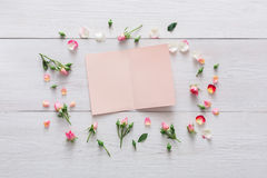 Valentine day background, paper card and flowers on white wood Stock Images