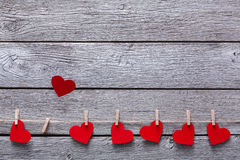 Valentine day background, paper hearts border on wood, copy space Stock Image
