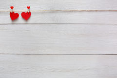 Valentine day background, paper hearts couple on wood, copy space Stock Photos